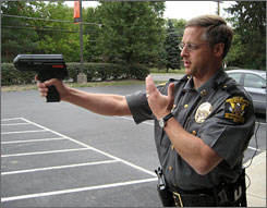 Deputy Chief Tim Sabransky of the Loveland, Ohio Police Dept. holds a radar device.