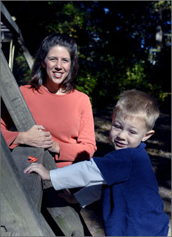 Trisha Stotler Meyer plays with her son Max, 3, at their Vienna Va., home. She recently had a both breasts removed following a 2005 diagnosis of cancer in one breast.