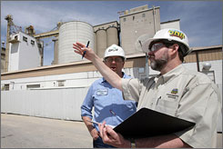 Department of Natural Resources environmental specialist Glenn Carper, right, conducts an air-quality inspection on May 1, 2007, at the Cargill's biodiesel plant in Iowa Falls, Iowa. Accompanying him is plant Superintendent Dan Schoenfelder.