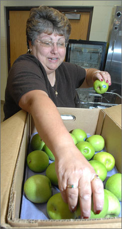 Betty Huddleston, a school cafeteria manager at Union County Middle School in Liberty, Ind., has been serving fresh fruit and vegetables at her school through a fresh produce snack program.