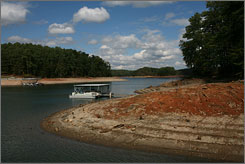 Boat docks rest on exposed rock and lake banks on Lake Lanier in Buford, Ga. The Army Corps of Engineers releases more than a billion gallons of water each day from Lake Lanier, which supplies more than 3 million Georgia residents with water.