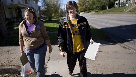 University of Missouri junior Jordan Stein, left, and University of Iowa freshman Mike Juntunen canvas a student neighborhood for Democratic presidential hopeful John Edwards in Iowa City on Oct. 20.