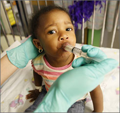 A syringe dispenses vile-tasting medicine to Jaiah Chatman, nearly 2, at Mount Washington Pediatric Hospital in Baltimore. The source for her lead poisoning: windows with lead-based paint.