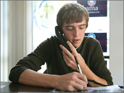 Sen. Barack Obama's campaign has made a concerted push with younger voters in Iowa, including 17-year-old volunteer Chris Elsenbast, of Ames, Iowa, who works the phone at the Obama campaign headquarters in Ames on Oct. 3.