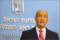 In this handout image provided by the Israeli Government Press Office (GPO), Israeli Prime Minister Ehud Olmert is seen at a news conference Monday in Jerusalem announcing that he has a treatable form of prostate cancer.
