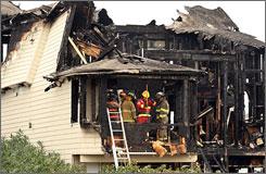 Investigators probe the fatal fire at a North Carolina beach house.