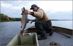 Marvin Defoe Jr., a member of the Red Cliff (Wis.) Band of Lake Superior Chippewa, says trout caught here, in Lake Superior, are safe to eat. Fish from inland lakes can be contaminated by mercury.