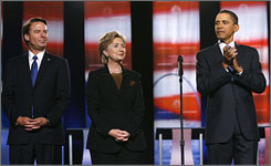 Democratic presidential candidates John Edwards, left, Hillary Clinton and Barack Obama stand on stage before the start of a political debate at Drexel University in Philadelphia.