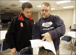 United Auto Workers International Representative Richard Greenfield, left, and Region 1A Community Action Program director Jim Pedersen talk at UAW Local 900 in Wayne, Mich.