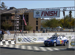 """""""Junior"""", a 2006 Volkswagen Passat Station wagon diesel, was the first vehicle to crosses the finish line of the Defense Advanced Research Project Agency's  2007 Urban Challenge."""