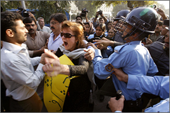 Police and demonstrators clash Sunday in Islamabad, Pakistan. Hundreds were arrested after President Pervez Musharraf?s decision to suspend constitutional rights.