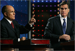 Republican presidential candidate and former New York City mayor Rudy Giuliani, left, makes a point as former Massachusetts Governor Mitt Romney, right,  listens during the Republican Party of Florida and Fox News Channel debate in Orlando, Fla. Oct. 21.