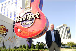 Biloxi Mayor A. J. Halloway stands in front of two of the city's star casino-resorts,the Hard Rock and the Beau Rivage (right).