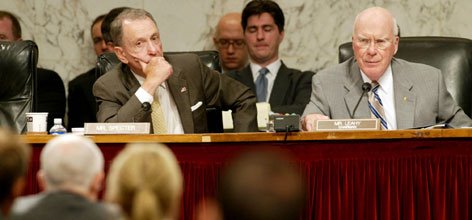 Sen. Arlen Specter, left, and Sen. Patrick Leahy, question Michael Mukasey as he testifies before the Senate Committee on the Judiciary on his nomination to be Attorney General of the United States.