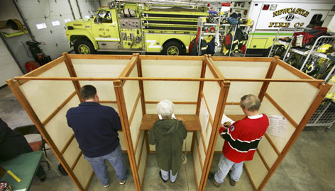 The Newcastle, Maine, Fire Dept. doubles as a polling place as three of the town's 1,500 registered voters cast their votes on Tuesday.