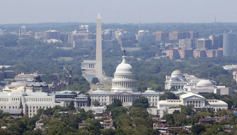 The Capitol building, foreground, and Washington Monument, center, are seen in this file aerial image taken over Washington in September.
