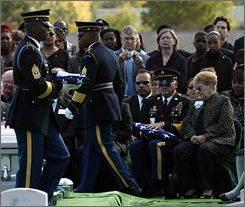 Edward D. Gabbard, of Polk City, Iowa, holds the flag presented to him, during the full honors ceremony at Arlington National Cemetery in Arlington, Va., on Oct. 12. Gabbard's wife, U.S. Army Command Sgt. Maj. Marilyn L. Gabbard, was one of 12 people killed when their Black Hawk helicopter went down in Baghdad in January.