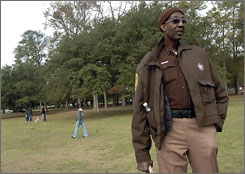 George Bell provides security at a park in Norfolk, Va., on his day off.