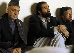 Afghan president Hamid Karzai, left, attends a Friday prayer service in Kabul for attack victims.