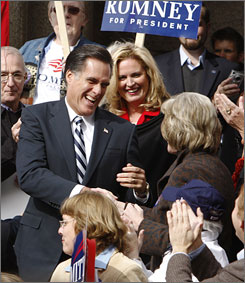 Mitt Romney and his wife Ann, center, greet supporters at a campaign rally in Concord, N.H., on October 29.