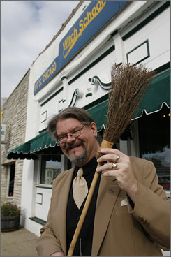 Witch School CEO Donald Lewis holds a broom he says is used for cleansing the ritual circle for a worship ceremony. The Rossville, Ill., school operates mostly online.