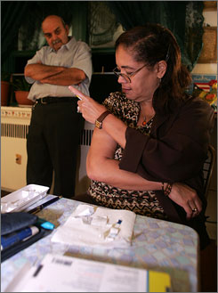 Sandra Velez, shown here injecting an anti-diabetes drug, had diabetes for years before she realized how serious it was.
