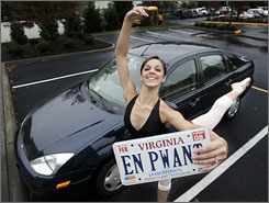 Brittany Diaz, of Richmond, Va., does a ballet pointe as she holds her personalized license plate, which displays the French pronounciation of the term.