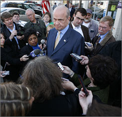 Fred Thompson talks to reporters after speaking to local residents during a stop at the Uncommon Grounds coffee house in Indianola, Iowa.