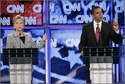Barack Obama and Hillary Clinton gesture as they speak during the CNN/Nevada Democratic Party debate at the University of Nevada Las Vegas in Las Vegas.