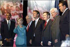 Democratic candidates on stage before the Univision forum in Coral Gables, Fla., in September. (l-r) Sen. Barack Obama, Sen. Hillary Clinton, former senator Mike Gravel, former senator John Edwards, Rep. Dennis Kucinich, Sen. Christopher Dodd and Gov. Bill Richardson.