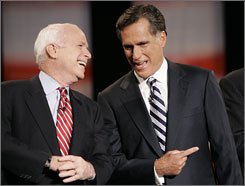Republican presidential hopefuls John McCain and Mitt Romney shared a light moment before a debate in Michigan Oct. 9.