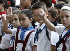 "Students hold up their hands in a tribute to the late Cuban revolutionary Ernesto ""Che"" Guevara in Havana on Oct. 3."