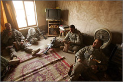 Members of the 101st Airborne Division, 3rd Brigade Combat Team, Alpha Company, rest in a farm house after conducting a house-to-house search Friday in the village of al-Awsat, south of Baghdad.