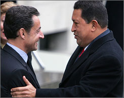 French President Nicolas Sarkozy, left, welcomes Hugo Chavez at the Elysees Palace in Paris on Tuesday.