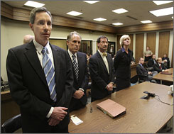 Warren Jeffs, left, and counsel react to the verdict against him Sept. 25 when he was found guilty on both counts of rape as an accomplice.