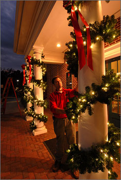 Kevin Wineiger inspects LED lights at City Hall last week in Monroe, Ga. LEDs use less electricity than incandescdent bulbs.