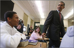 Democratic presidential hopeful Sen. Barack Obama shares a laugh with student Iam Torres, left, at Manchester Central High School in Manchester, N.H., on Tuesday.
