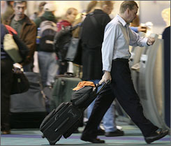 Travelers are shown at Portland International Airport at the start of the Thanksgiving holiday week Monday, in Portland, Ore.