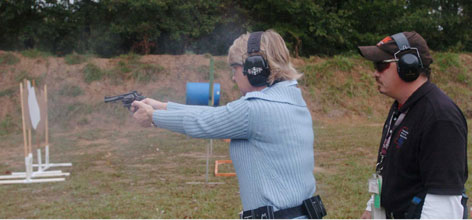 Kathy Adkins of Madison, Miss., shoots under the instruction of Cliff Cargill. She enrolled in his course after several friends became crime victims.