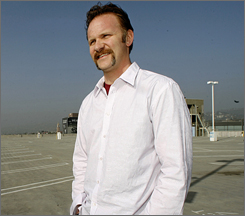 Morgan Spurlock talks about the Stop Shopping campaign by performance artist Bill Talen in L.A. on Tuesday. Spurlock produced What Would Jesus Buy?   A documentary featuring Talen, who goes by Rev. Billy, and his Church of Stop Shopping.
