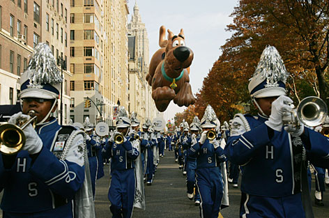 The Scooby Doo balloon floats behind a marching band during the 81st annual Macy's Thanksgiving Day Parade.