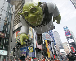 The Shrek balloon moves through Times Square during the Macy's Thanksgiving Day parade Thursday, Nov. 22 in New York.