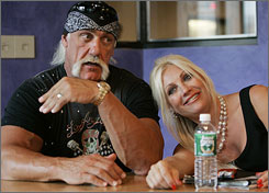Linda Hogan, right, is seeking a divorce from husband Hulk Hogan, left, according to a newspaper report.