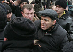 Chess grandmaster and opposition leader Garry Kasparov, center, pushes through the crowd before being detained by the police during an opposition rally in Moscow.