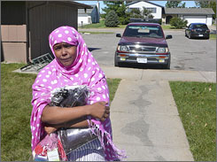 Asha Mohamed, a refugee from Somalia, is one of a growing number of African refugees who are moving to rural Nebraska to work in meat packing plants.