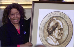Rep. Julia Carson, D-Ind., unveils the Rosa Parks Congressional Gold Medal drawing in 1999 in Washington, D.C. Carson won enactment of the measure awarding the medal to the civil rights figure that year.