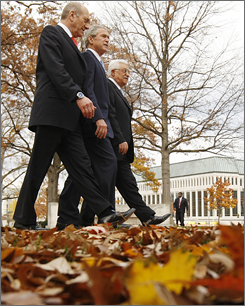 President Bush flanked Tuesday by Israel's Ehud Olmert, left, and Palestinian head Mahmoud Abbas on Tuesday.