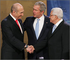 Israel's Olmert, Bush and Palestinian leader Abbas during the Annapolis Conference in Memorial Hall at the United States Naval Academy in Annapolis, Md.