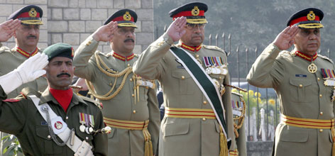 Pakistani President Pervez Musharraf, center, salutes during an honor guard ceremony at the armed forces headquarters in Rawalpindi, Pakistan, on Tuesday. Musharraf was bidding the troops farewell.
