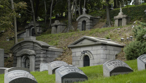 Gravestones and mausoleums are shown at the Green-Wood Cemetery in the Brooklyn borough of New York in this 2006 file photo. More than a half a million dollars in political donations have been given on behalf of dead donors over the past eight years.
